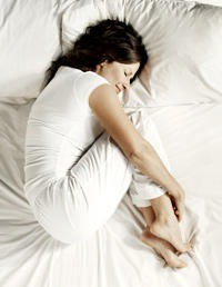 Try adopting the foetal position. Sometimes this can comfort and calm the period pain.
