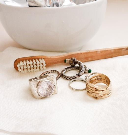 Remove your jewelry and use the toothbrush to gently scrub around any prongs, groves in the jewelry, or gemstones. We tested this cleaner on gold, silver, sterling, diamonds, and other gems with glittering results. Rinse after cleaning, and pat dry.