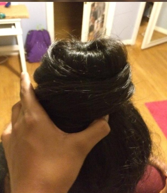 Twist remaining hair around the bun