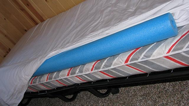 Tuck one under a fitted sheet to keep a child ( or adult) from rolling out of bed