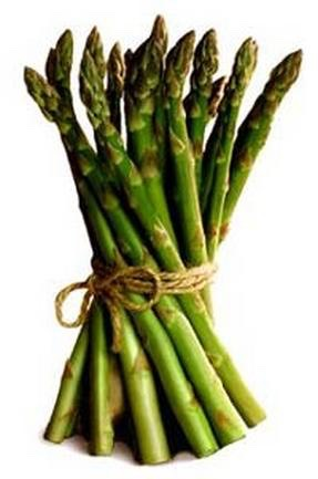 Now you're gonna need asparagus just put it in the pan and let it soak in the butter for a little while.