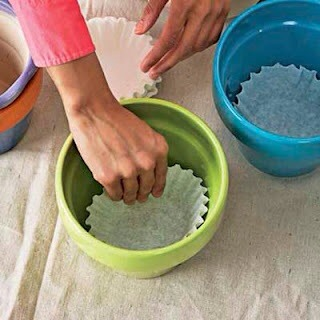 Flower Pot Drain Hole Cover: Just lay a coffee filter in the bottom of the pot covering the hole before filling the pot. The soil will stay in the pot and the water will still drain out because that is what coffee filters are designed to do; let water through. They last for a long time.