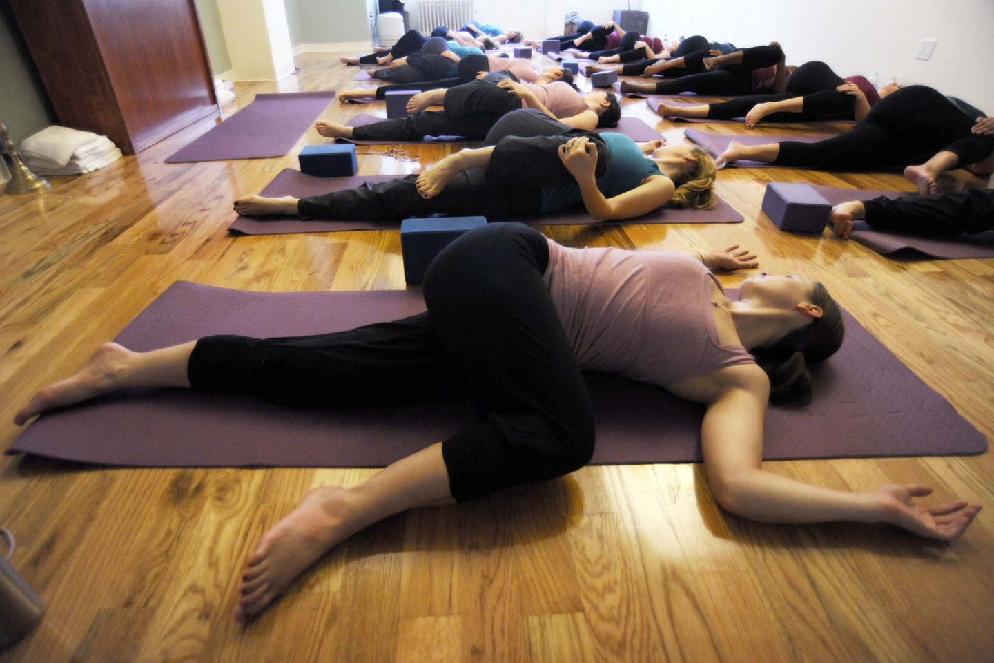 Supine twist: best to do before getting out of bed in the morning. On your back, hug your knees to your chest. Hold your legs behind the knees and gently bring your knees to the bed on your right side. Look to the left. Repeat on the other side. This move awakens your spine.