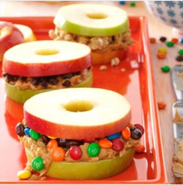Apples sandwiches with peanut butter and m&ms