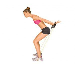 6) Cleavage Kickback Stand on an exercise band, feet hip-width apart, holding an end in each hand. With arms down at sides, squat and bend slightly at waist, keeping back flat.
