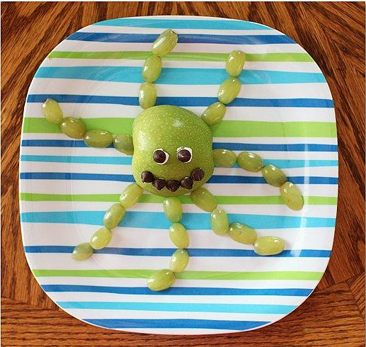 Octoapple Slice some grapes and an apple into the shape of a sea creature.