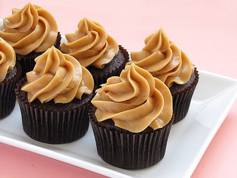 2 tablespoons brewed coffee 1 3/4 cups all-purpose flour 1 cup good cocoa powder 1 1/2 teaspoons baking soda 1/2 teaspoon kosher salt Kathleen's Peanut Butter Icing, recipe follows Chopped salted peanuts, to decorate, optional 1 cup confectioners' sugar 1 cup creamy peanut butter