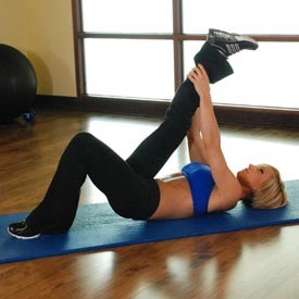 Hamstring stretch  If you cannot reach your leg use a belt or a strap.