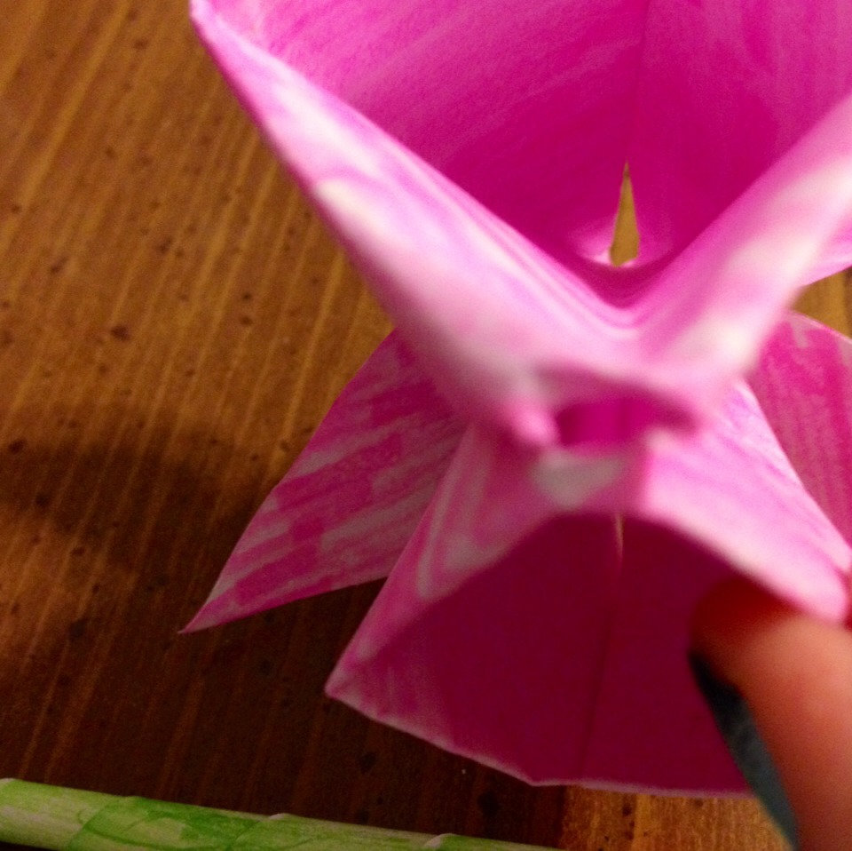 Find the small hole at the bottom of the flower and insert the stem.