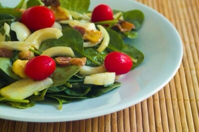 Warm Spinach SaladEggs, bacon, onion, and tomatos unite to make this delicious spinach salad. The secret is in the dressing ... that's right, there's extra bacon drippings in there for a little extra indulgence.