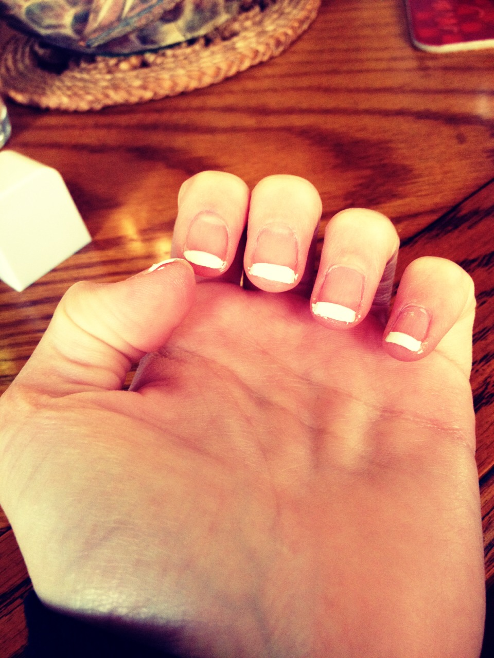 While the polish is still wet take the tape off I would do one nail at a time