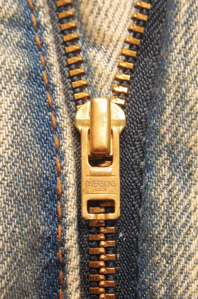 Stuck zipper? Take a normal pencil and run the lead on the stuck part of the zipper back and forth. This will loosen the stuck zipper from it place .