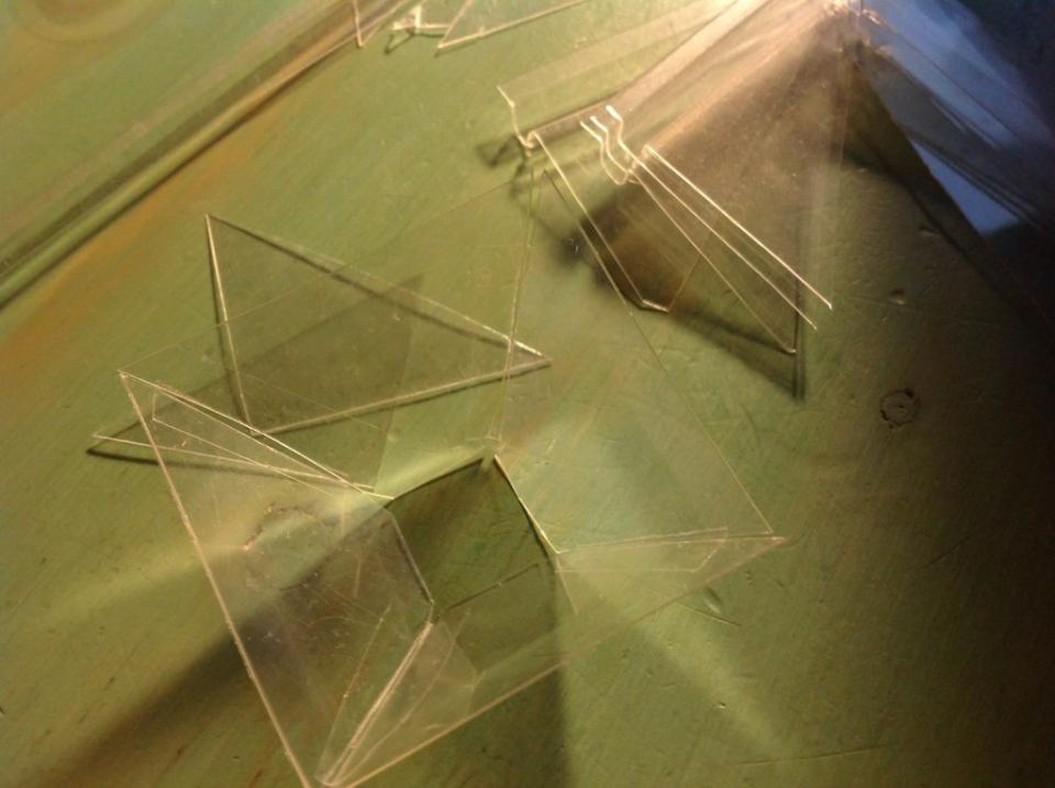 Step 1 Cut four trapezoids out of plastic packaging (or a CD case, which you will need a knife or glass cutter for).