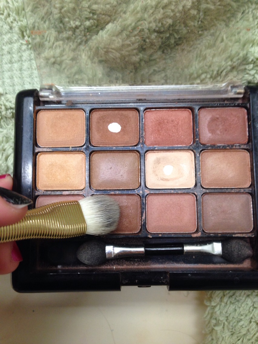 First you will be using your large shadow brush with dark brown shadow.