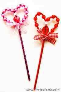 Ask for an adult's help 10:For added safety, fix the joint between the drinking straw and the bottom of the beaded heart using a hot glue gun. You may tie a ribbon around this joint to accent your wand.   Enjoy using your pretty beaded heart wand! Wouldn't it be a great project to make for Valentin