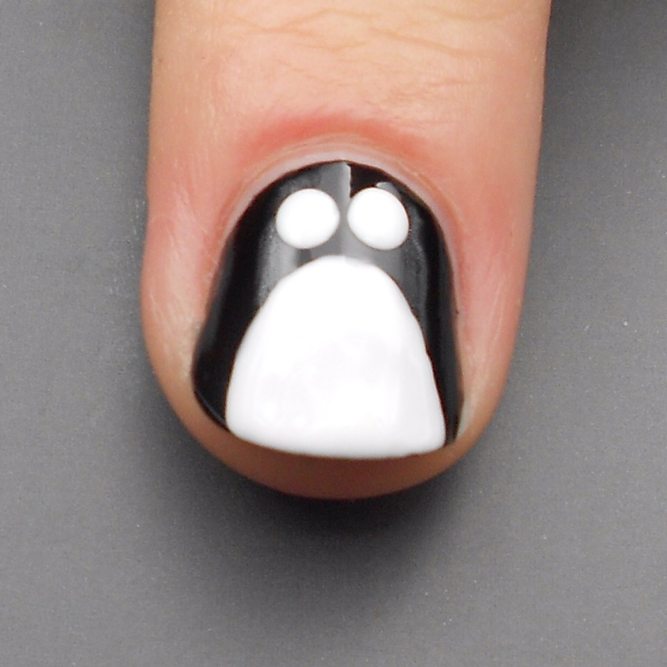 Step 3:  Next, use a large dottng tool dipped in your white polish to create two white eyes!
