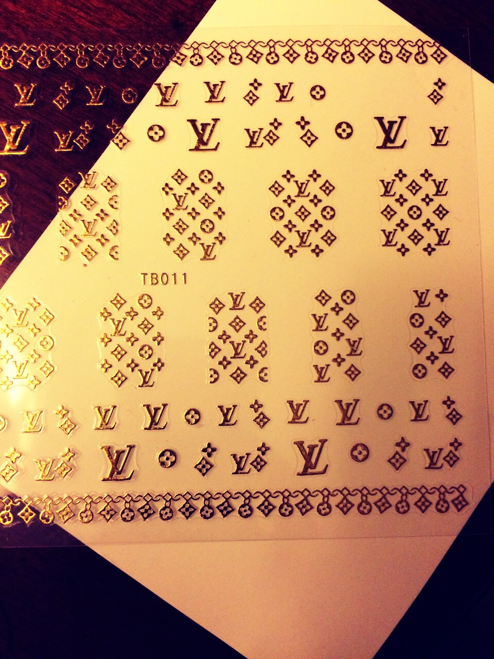 You can purchase these alloy nail decals on eBay for approximately 1-3 dollars