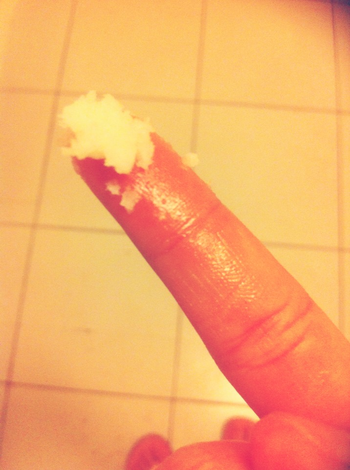 Get some coconut oil on the tip of your finger. It doest have to be alot. As you can see ,it does not look like an oil but warm it up by rubbing your fingers together. Then apply it on your eyes.