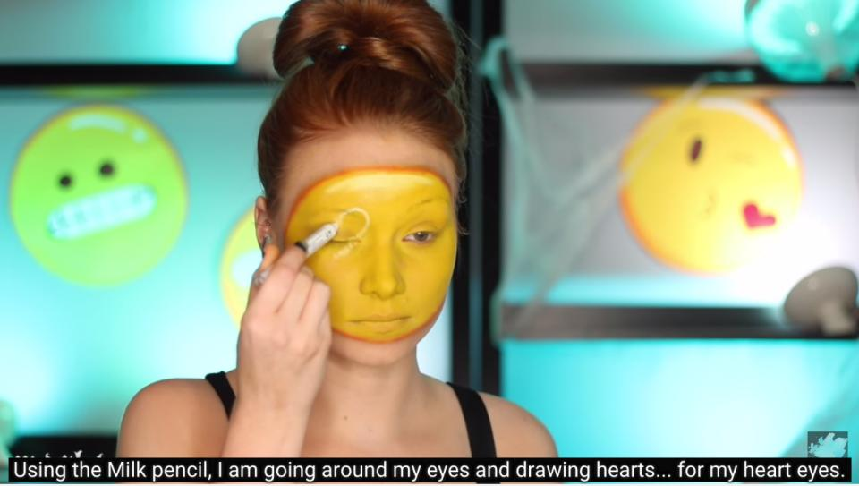 This way, she can make all the emojis by just switching up the eyes and lips. She uses a white eyeshadow pencil to draw on the hearts.