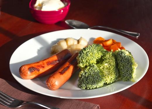 Day Two Dinner  2 hot dogs (no buns) 1 cup broccoli 1/2 cup carrots 1/2 banana 1/2 cup of vanilla ice cream