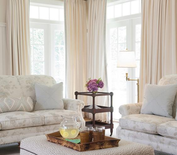 Ladylike Charm Soft, muted colors and sinuous curtains infuse a living room with a little feminine grace.