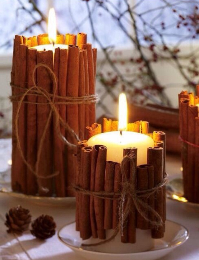 Just tie cinnamon sticks around a regular candle. Heat from the candle will make the scent of the cinnamon spread throughout the entire room :)