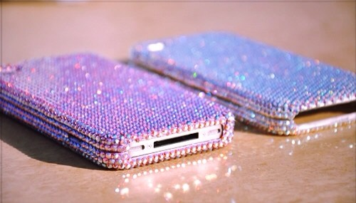 If you're more of the glitz and glam type, then you couldn't possibly go wrong with rhinestones. Granted, they can be tiny so this one can be a little tedious. But you don't have to cover your entire phone, maybe just a little stone here and there. I like the cascading effect personally.