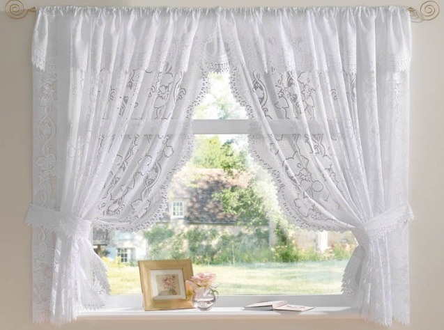 Once your nets have finished in the washing machine take them out and hang them straight up don't wait for them to dry first and then sit back and look at those bright white nets. Don't they look great and as an added bonus your room will smell great to because you hung them up wet
