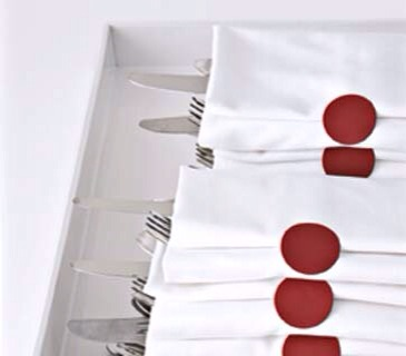 Big, bright dot stickers give ho-hum plain white cloth napkins the seal of style they need to pass holiday muster. They also keep utensil-filled napkin envelopes fastened in transit from buffet table to mealtime―special delivery, indeed.