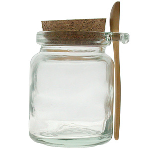 First take your jar and put about half the container of sugar.
