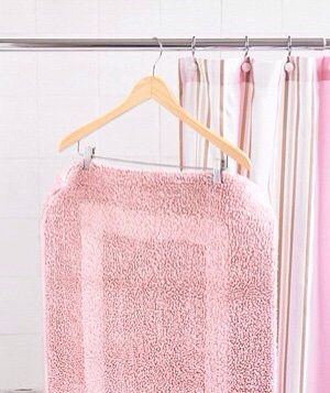 Pant Hanger as Drying Rack Use a pant hanger to air-dry a bath mat after showering. Simply hang it over the shower curtain rod.