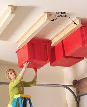 Bins on the Ceiling  Turn the garage ceiling into usable storage space. Genius!