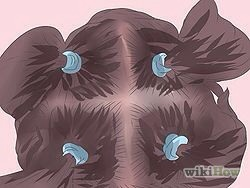 6) Divide your hair into four sections. At least. If you'd like to divide into 12, that wouldn't be a terrible idea. Use hair clips or rubber hair ties to keep your hair in place. You don't want your post-dyed sections to mesh with the sections you haven't done yet.
