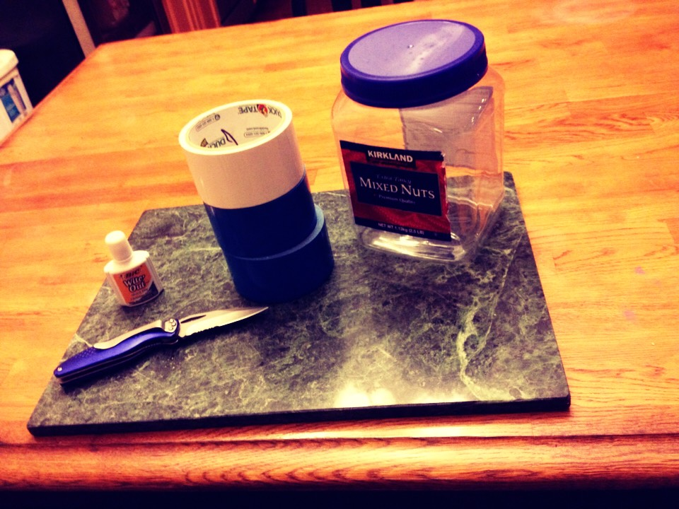 1. gather materials needed -blue and white duct tape -knife -heavy duty cutting board -white paint/whiteout -jar of your choice