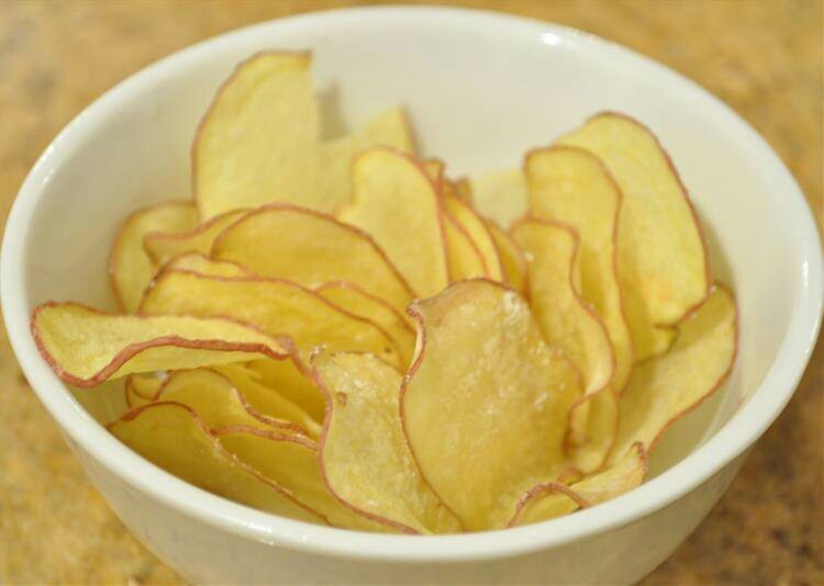 Potato chips are high in salt, fat and empty calories causing you to load up and almost never get full!  Buy baked chips instead, and always check the sodium on the nutrition label!