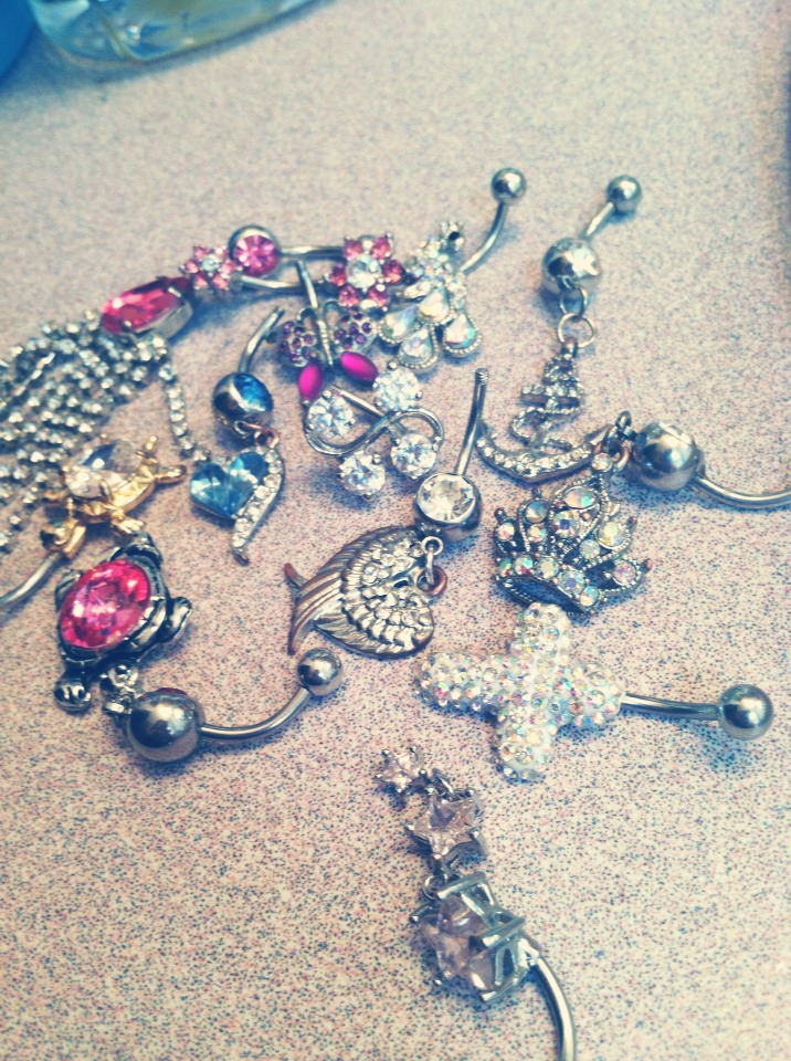 Buy on eBay! all of these belly button rings were dirt cheap! I bought each of them for  $0.24-1.50, that's an amazing price compared to paying $14 at places in the mall. it's simple, all you have to do is have a credit card or Paypal account. I buy all of my jewelry on ebay and swear by it! (: