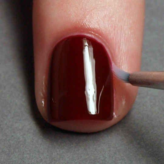 Drip a small brush in nail polish remover to erase any mistakes.