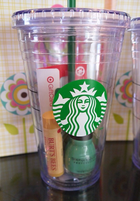 9. Gift In A Cup Who couldn't use an on-the-go insulated cup?! Fill it up with some of their favorite goodies (gift cards, drink packets, lip gloss, nail polish, candy, or anything else that will fit) and you've got a gift that works for just about anyone!