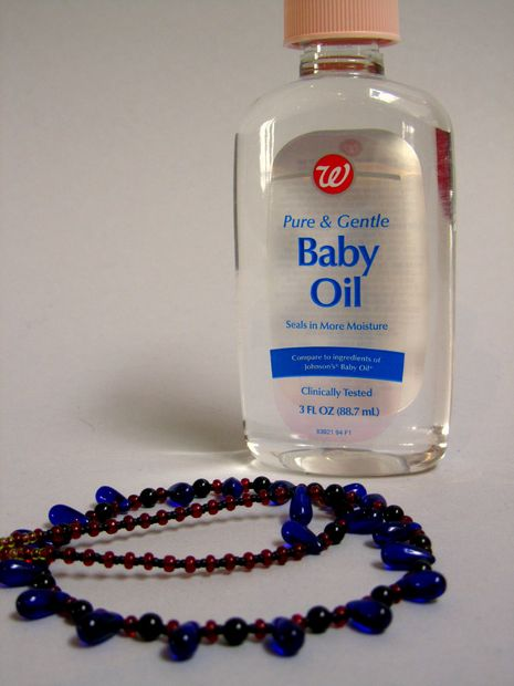 before throwing away your tangled  necklace try lubricating the metal links with baby oil it will separate more easily. Using a pin to work out the knot or tangle after dunking the chain in baby oil.