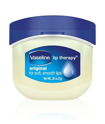 """1. Apply a generous amount of Vaseline to your lips. It will moisturize your lips painlessly. Leave this on until your lips are visibly less irritated. *Try SMILING while applying it to get it in all the """"creases"""" of your lips*"""