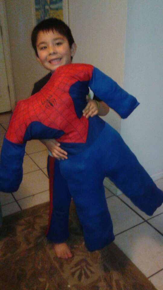 Take your childs old halloween costume, turn it inside out, sew neck arms and legs, flip right side out, and stuff with pillow stuffing. Then sew up the back ...you have a kids wrestling pillow and a keepsake.