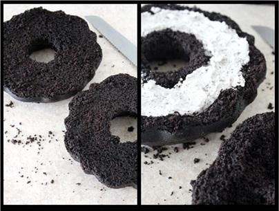 Now, use a sharp, serrated knife to cut the cake in half. Flip the cake so the inside of each half is facing up.  Use a tablespoon to dig a small cavity out in each side of the cake.  Scoop the oreo filling into the cavity and spread it evenly. Put the layers back together and align them.