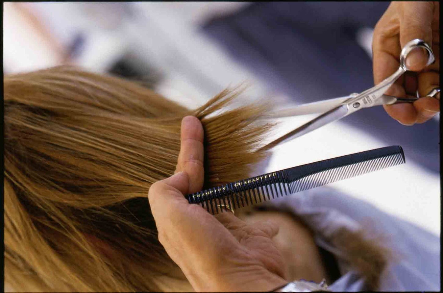 Get frequent hair cuts to trim split ends