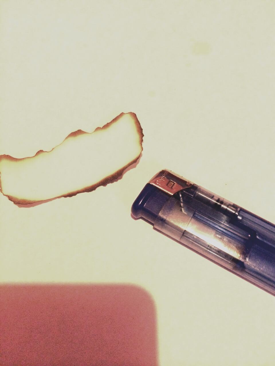Use the lighter to carefully burn the edges of the paper to give it an antique effect 😃