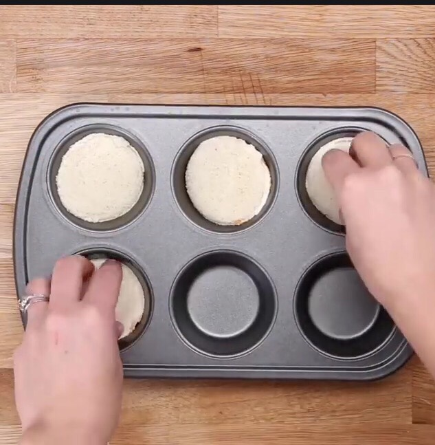 Gently insert bread circles in muffin tin ( don't forget to spray with PAM 😉)