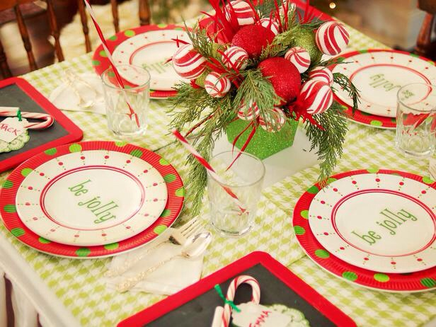 Candy-Inspired Centerpiece Perfect for a kids' table, this simple, shatter-proof centerpiece is made from foam candy cane spheres, tree trimmings, red feathers and glittery plastic ornaments, all tucked inside a Chinese takeout-style box.