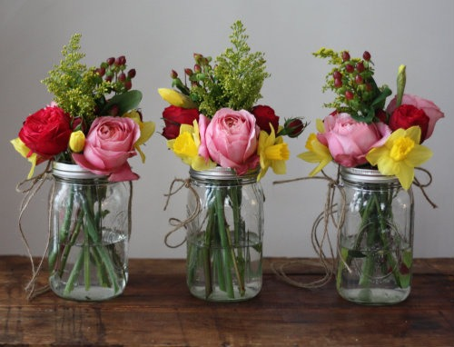 Mason jars flower holders -mason jars - fake flowers ( or real ) - paint ( optional ) - glitter ( optional ) ------------------------------- - paint brushes - news paper
