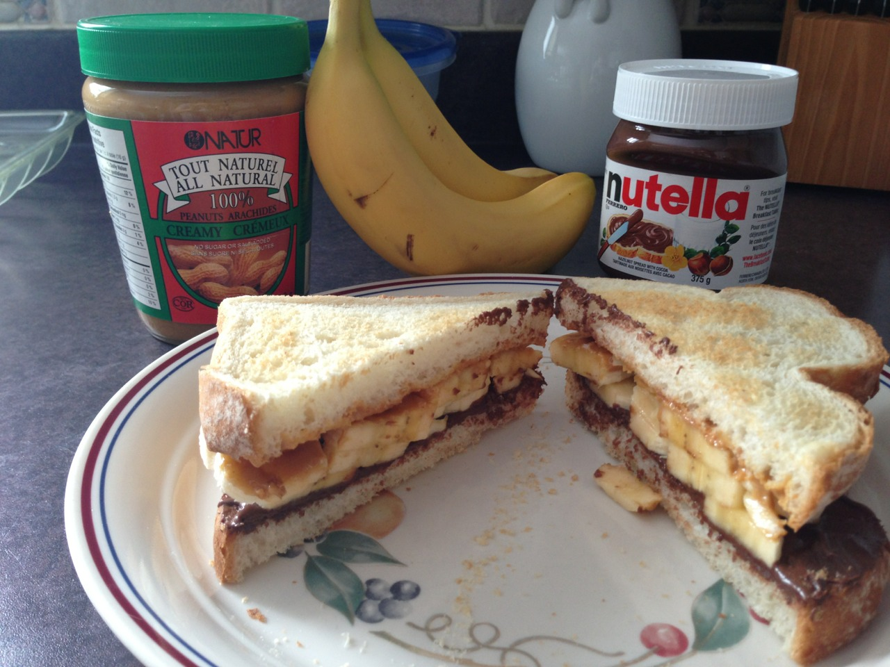 What you'll need: 2 slices of bread Peanut butter Nutella 1 Banana