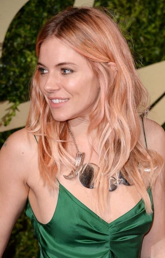 Rose gold became popular in 2013 and I don't see it losing its appeal in 2014. This mix between blonde, brown, pink, and gold is soft with subtle drama. Rose gold is the perfect color to sport in the spring and summer of 2014