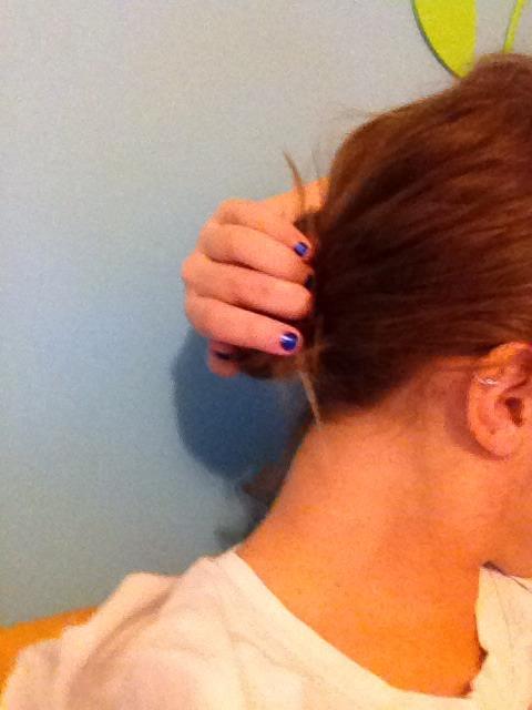 Tuck hair underneath bun
